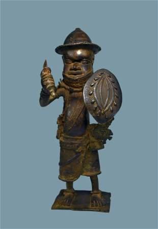 A Benin Bronze Warrior Sculpture