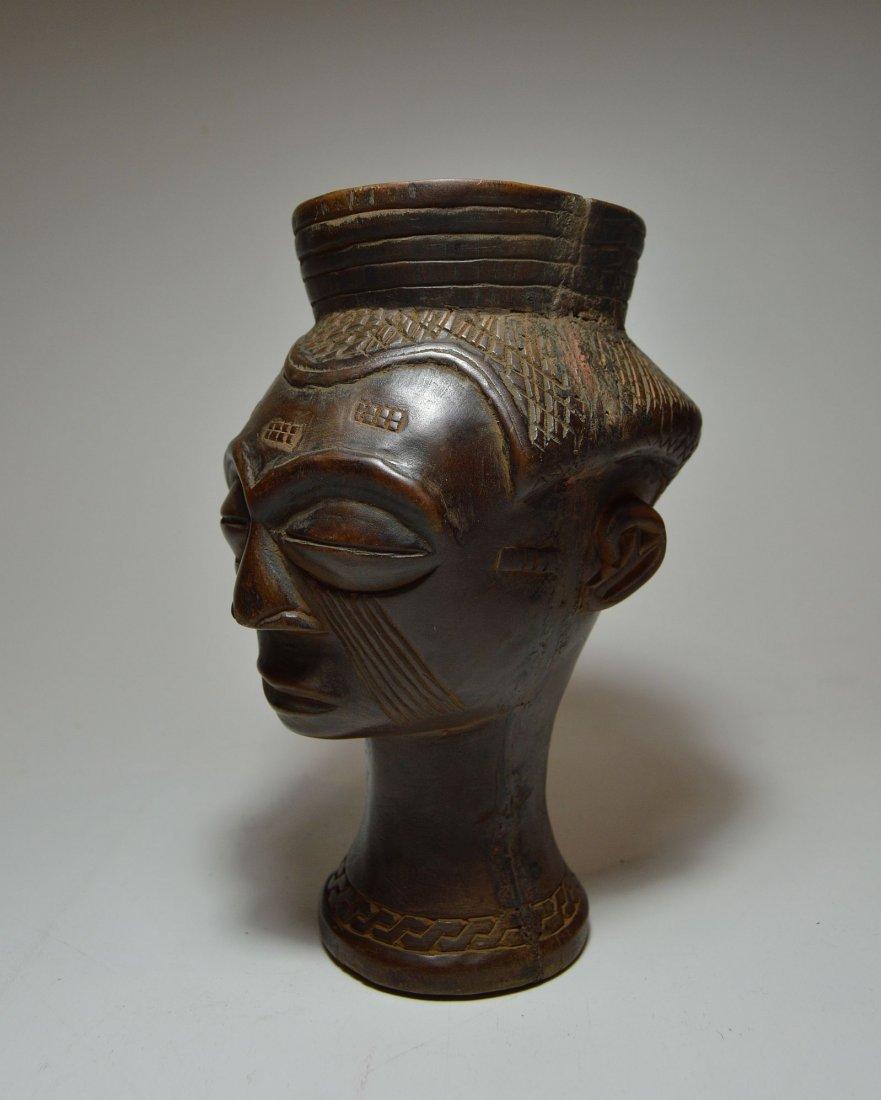 A Fine Kuba Palm wine cup w/ ancestor face, African Art