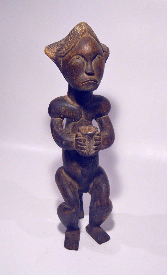 A Fine Female FANG African sculpture with upward gaze