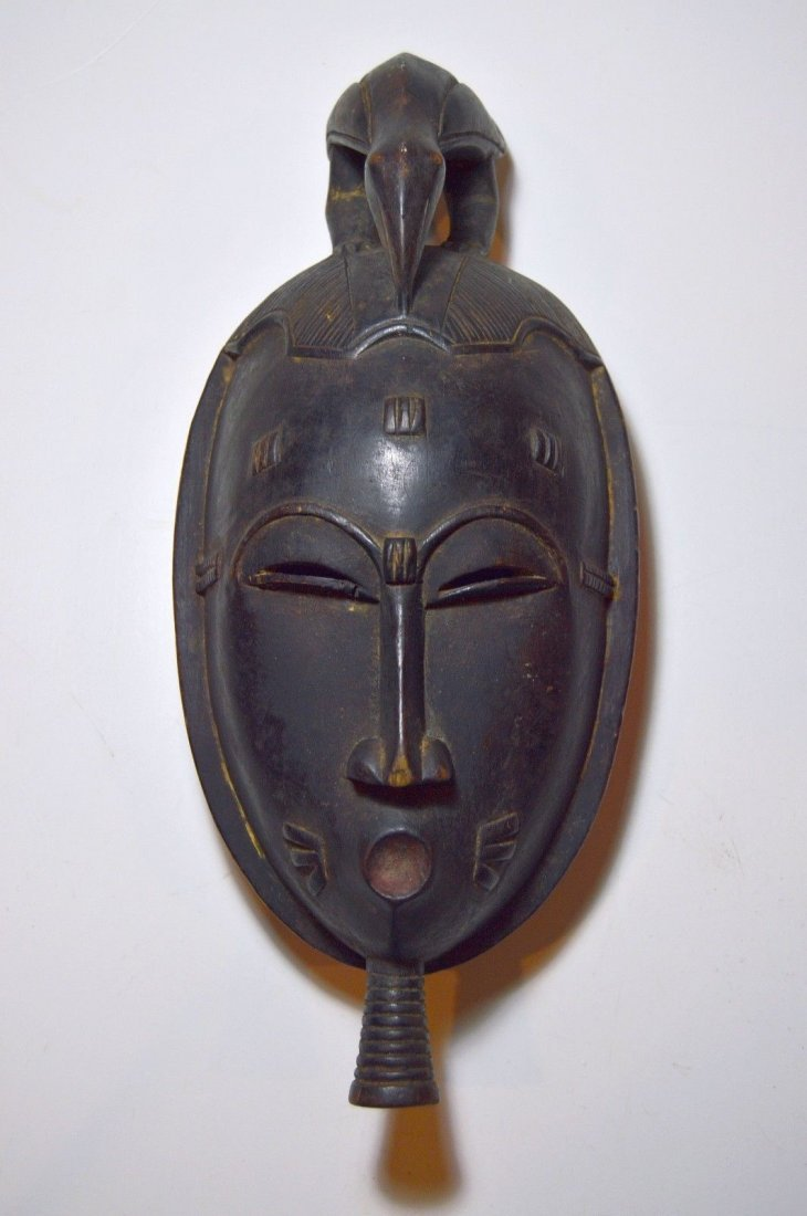 A Classic Baule African mask with Avian finial