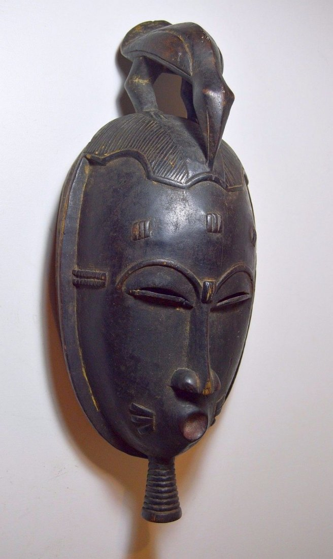 A Classic Baule African mask with Avian finial - 2