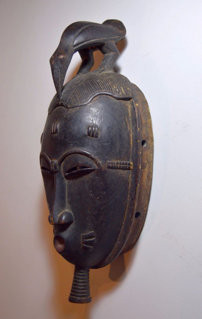 A Classic Baule African mask with Avian finial - 3