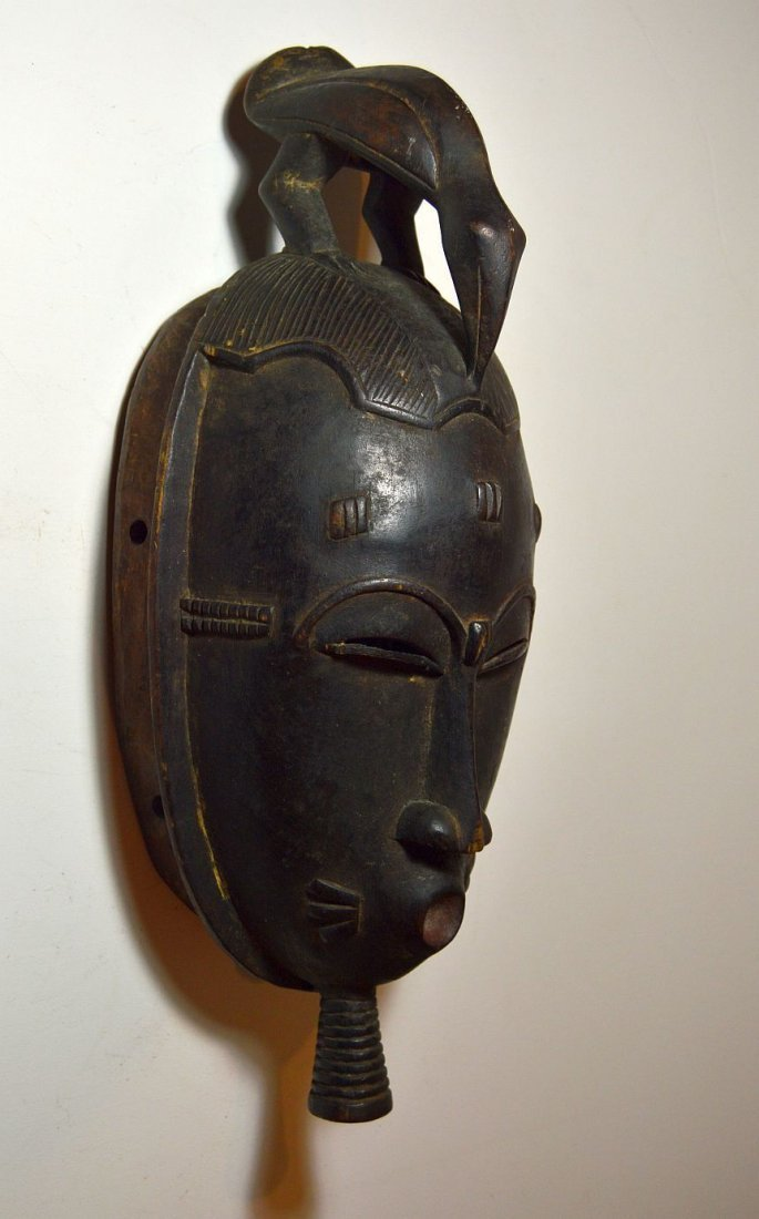 A Classic Baule African mask with Avian finial - 4
