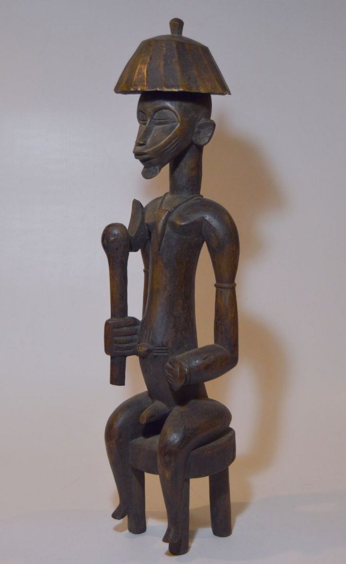 Senufo Seated Chief Sculpture with Prestige Axe, Africa