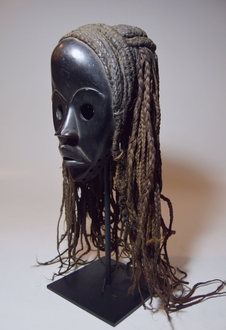 A Fine Dan Poro Society African mask with Headdress