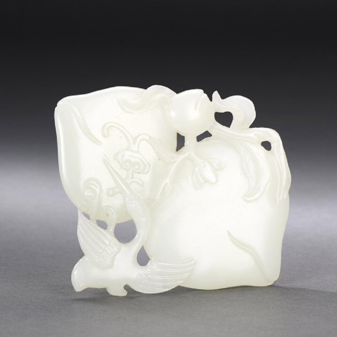 CHINESE CARVED WHITE JADE CRANE AND PEACH PENDANT