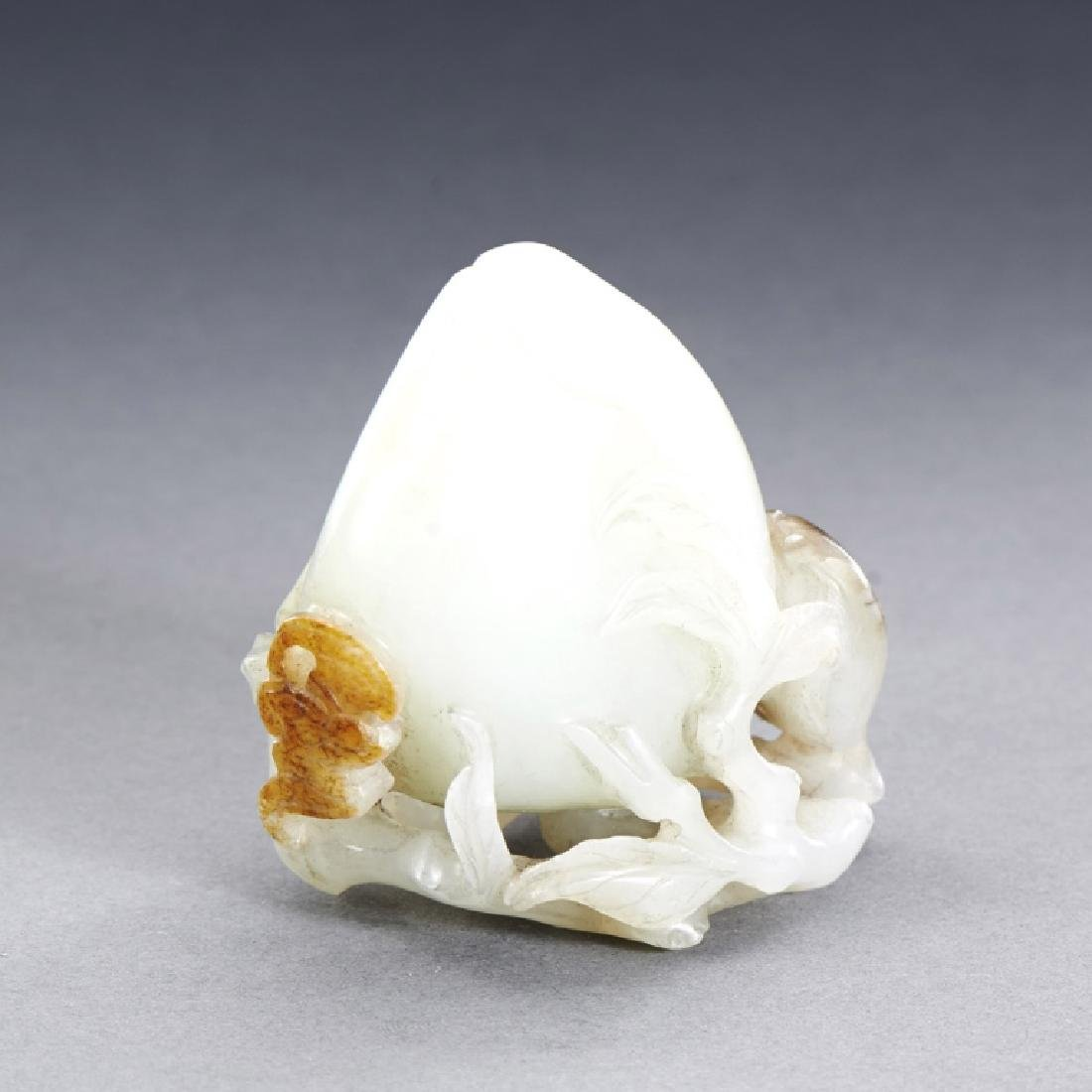 CHINESE WHITE AND RUSSET JADE PEACH CARVING