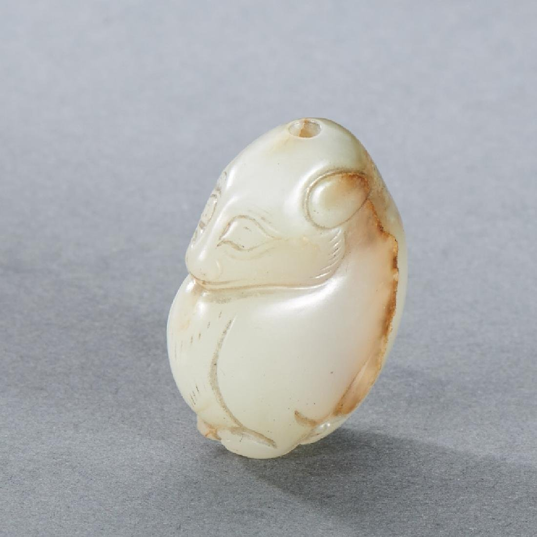 CHINESE WHITE AND RUSSET JADE BEAR CARVING