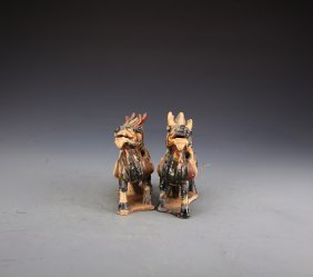 Pair of Chinese Qing Styled Tri-Colored Glazed Kylin