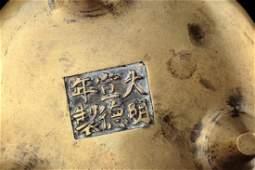 A bronze tripod censer, Qing dynasty,