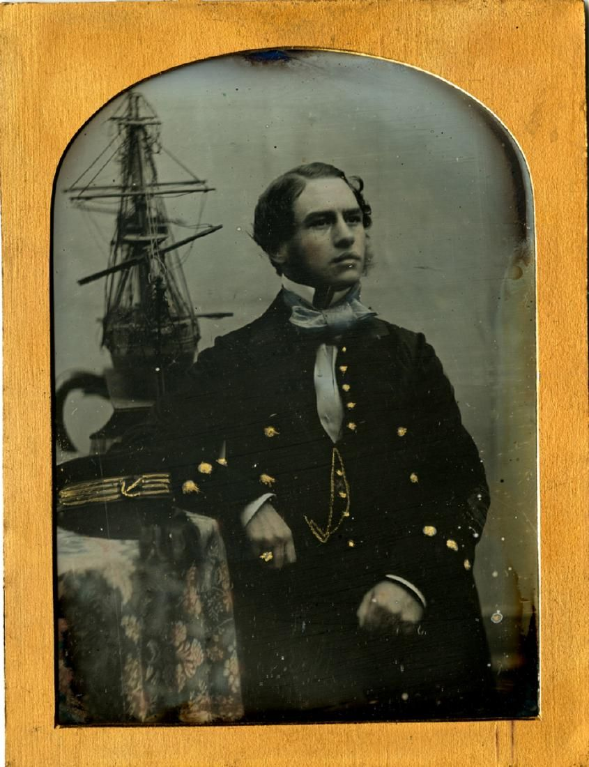British naval officer with ship model. 1/4 plate