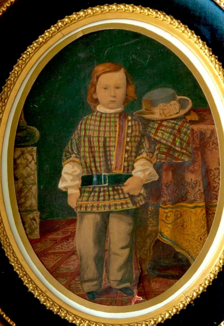 Hand-colored Talbotype . A well dressed boy by Williams