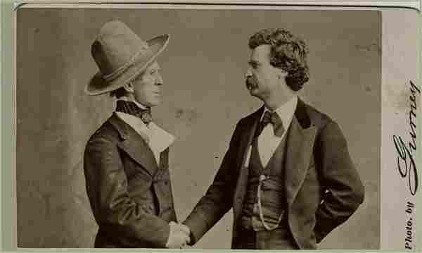 Mark Twain shakes hands with John T. Raymond. CDV by