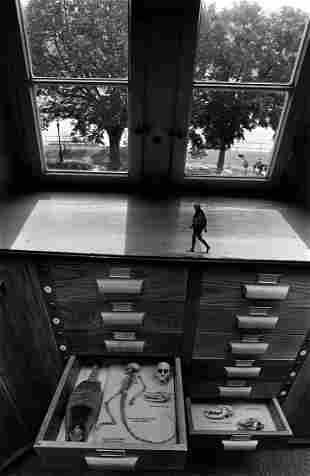 Jerry Uelsmann, Untitled, figure on filing cabinet.
