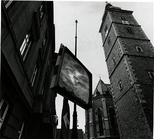 Jerry Uelsmann, Untitled, Clouds on a sign between
