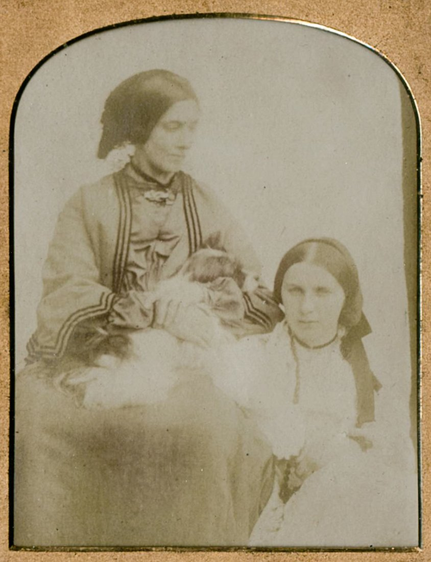 TWO WOMEN, ¼ PLATE CALOTYPE IN A CASE.