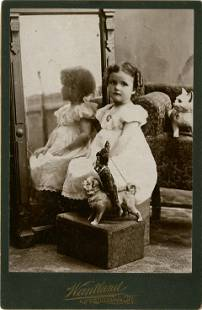 GIRL, MIRROR, CERAMIC KITTY, PUPPET ON CERAMIC DOG