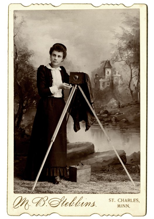 A woman photographer with her camera.