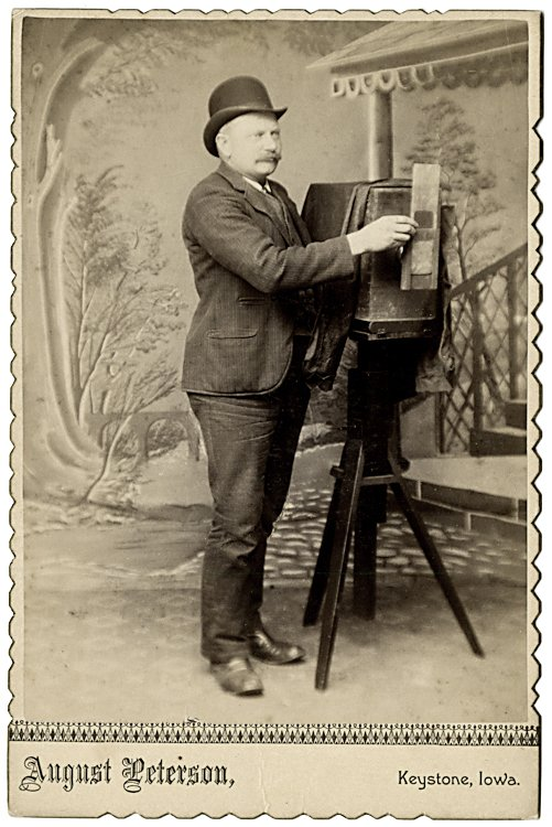 A photographer holds a masking plate or external