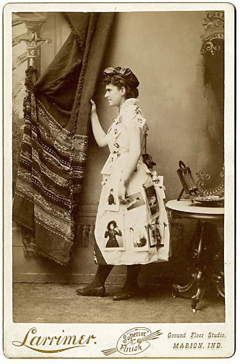 A photo advertising lady, posed in profile, with