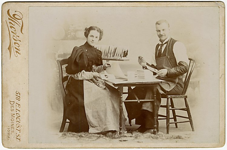 Pasting the photographs to cabinet card mounts.