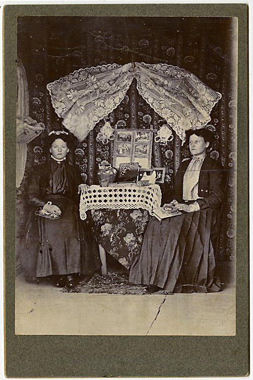 A booth offering cabinet cards and albums.