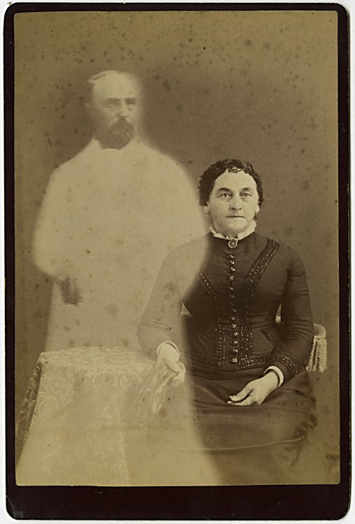 A spirit photograph. A woman is visited by the spirit