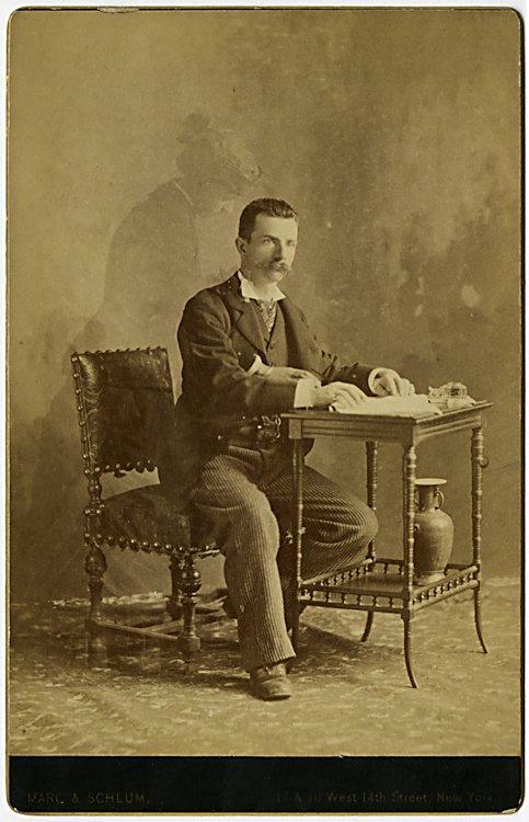 A spirit photograph. Touching a paper [letters?] a man