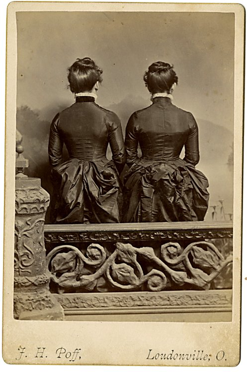 Two women from the back.