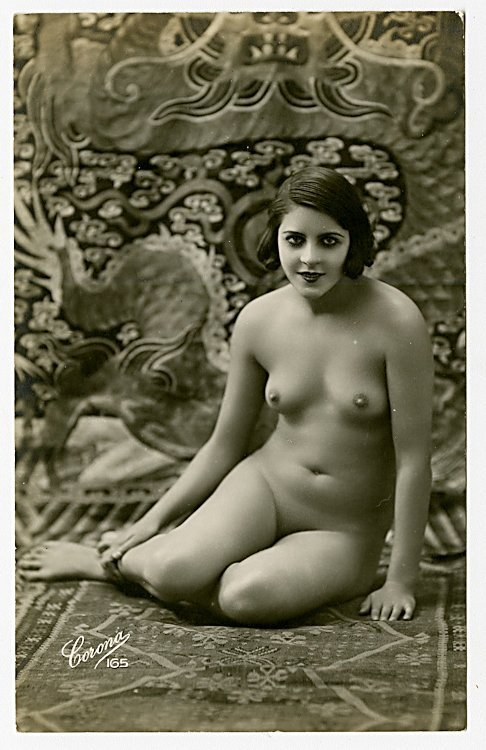Four photo postcards of nudes.