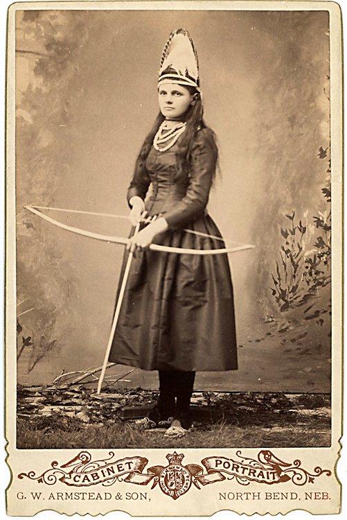 A woman archer in uniform.