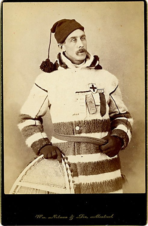 A man with a snowshoe, with medals.