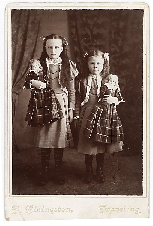 Sisters with their dolls.