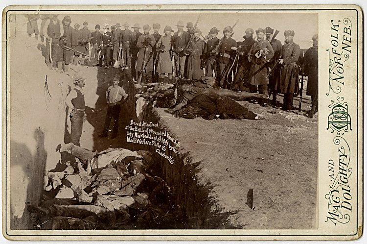 Burying the dead at Wounded Knee.