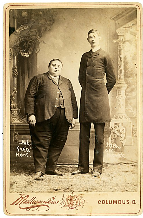 Fred Howe (fat man) and George Moore (tall man.)