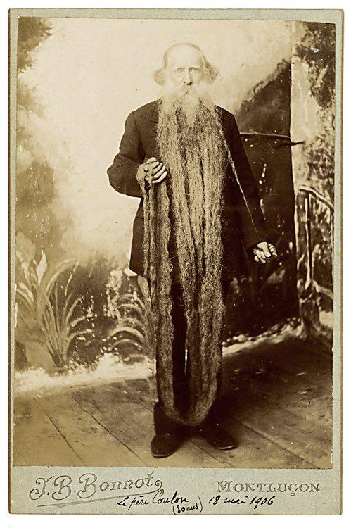 A man with a very long beard.