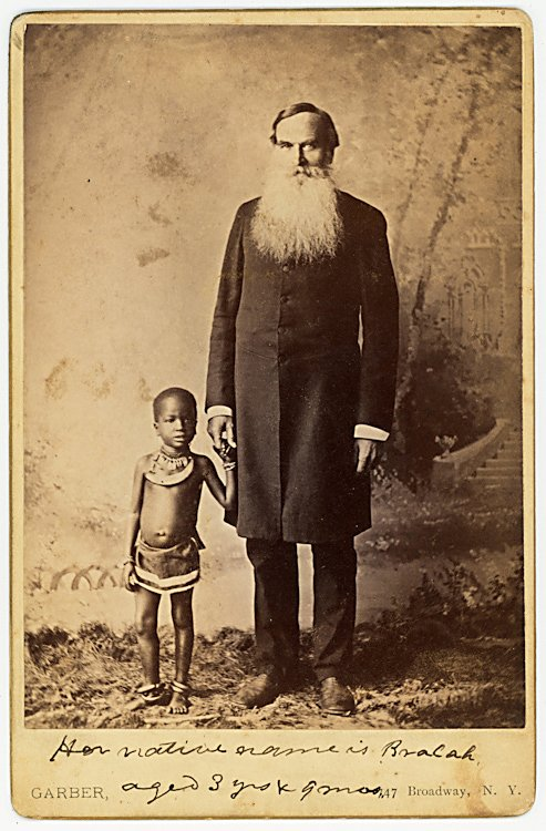 An African midget girl with her guardian or agent.