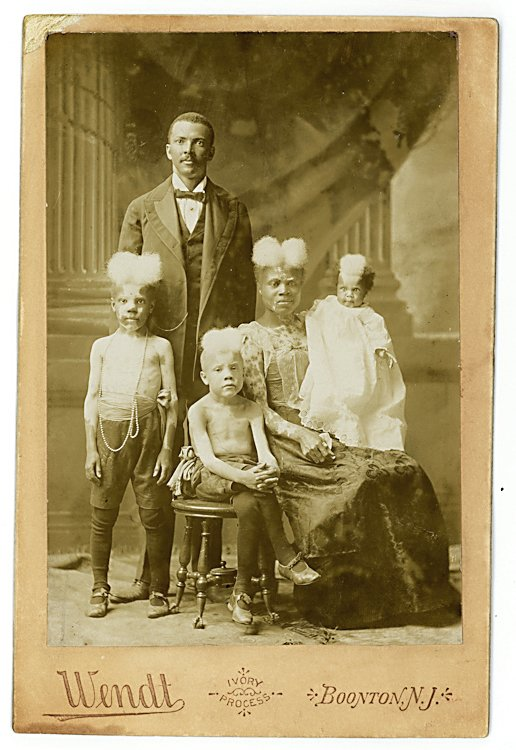 """Piebald family, with """"normal"""" fathers standing."""