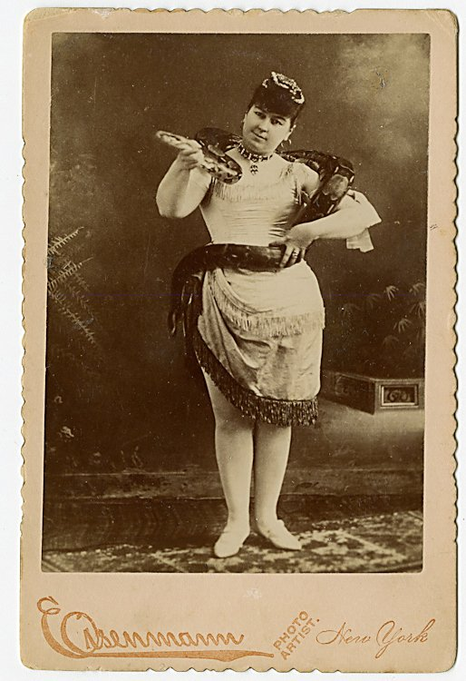 Miss Leland, snake charmer, with a 10-foot snake.