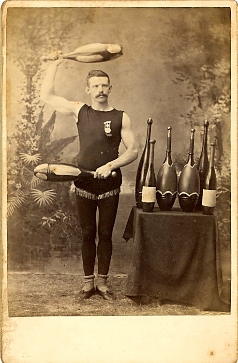 A juggler with clubs and bottles.