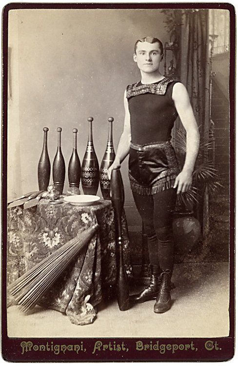 A juggler with clubs, knives, plate, umbrella