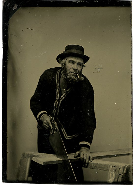 A pipe-smoking carpenter sawing.