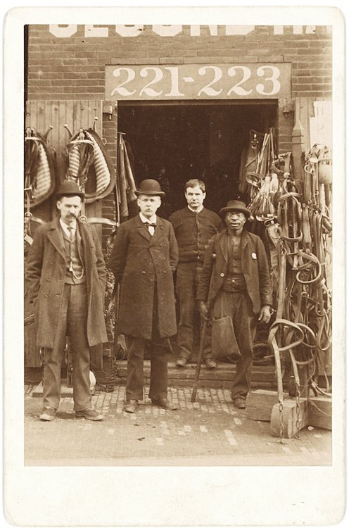 A harness shop, with the owners and workers.