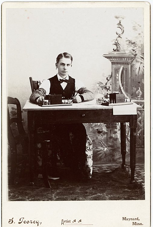A telegrapher at his desk.