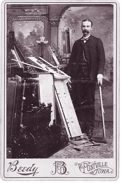 An organ builder or repair man.