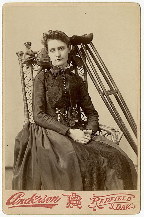 A woman and a girl with crutches. 2 cabinet cards.