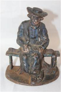 ANTIQUE CAST IRON AMISH MAN ON A BENCH