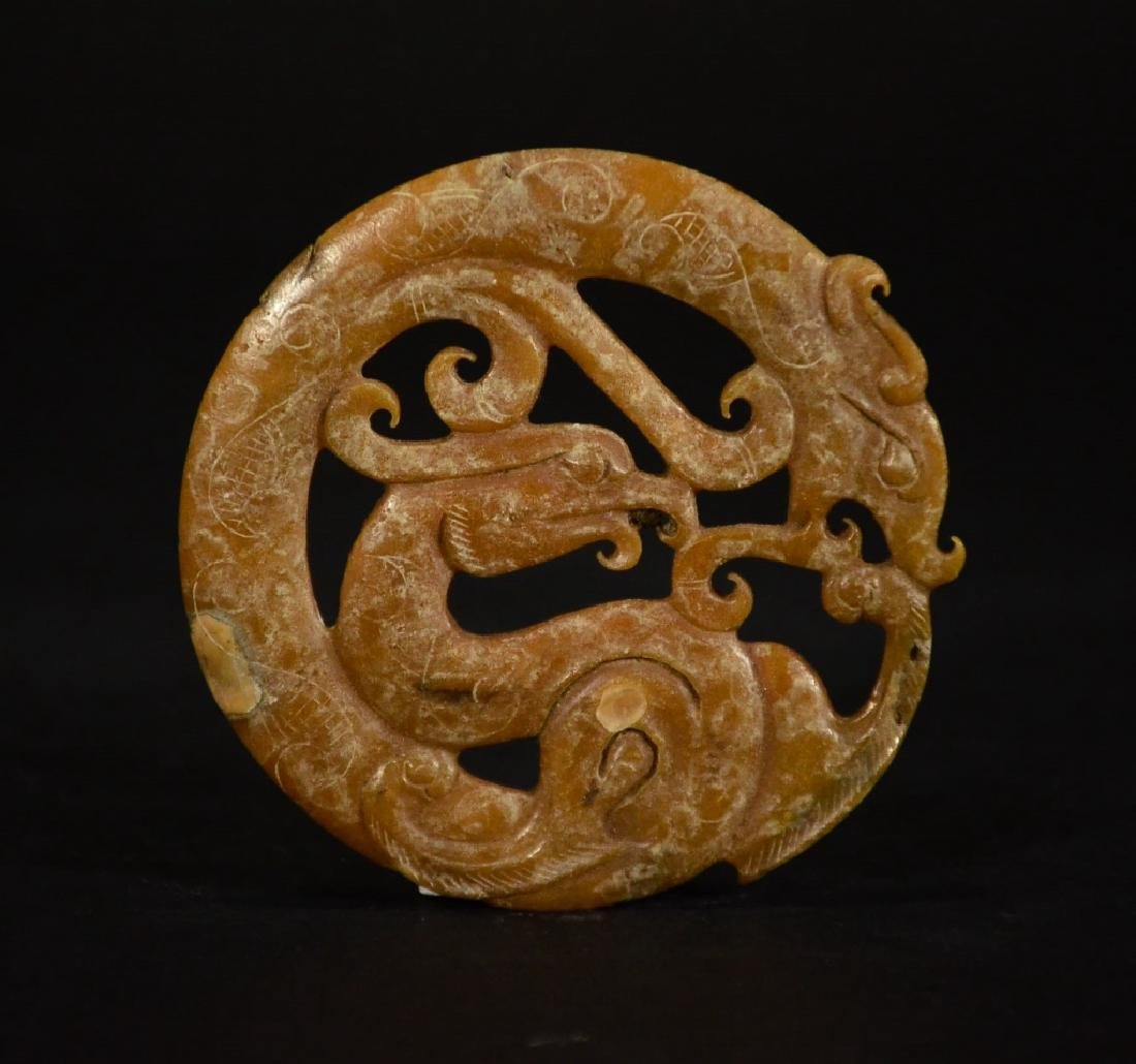 A CARVED YELLOW JADE DECORATION