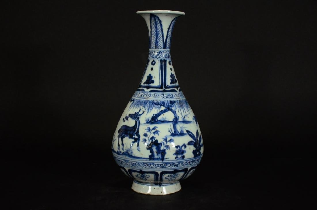 A BLUE AND WHITE VASE - 4