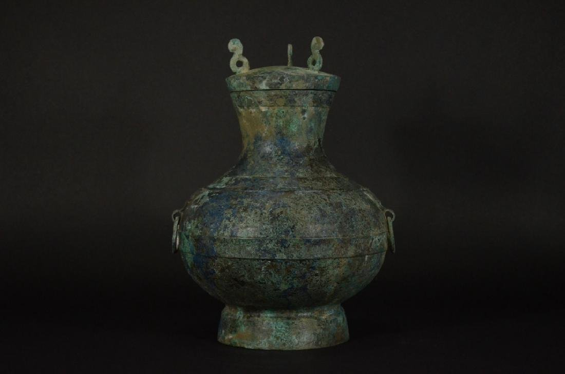 A BRONZE BEAST VESSEL WITH LID